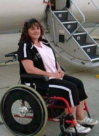 kristi foster in a wheelchair
